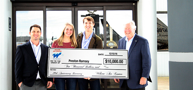 (From L to R: David Holmes, Controller; Shelby Ramsey: Preston Ramsey (Winner); Bob Wilson, President- Wilson Air Center)